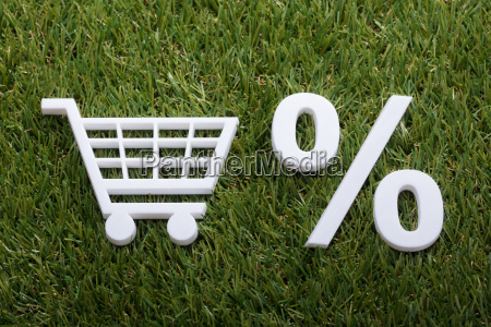 miniature shopping cart and percentage sign
