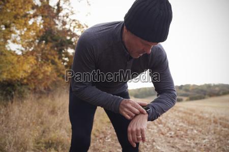 mature man on autumn run around
