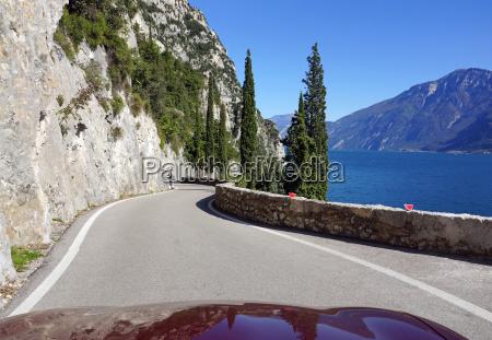 cabrio driving on lake garda in