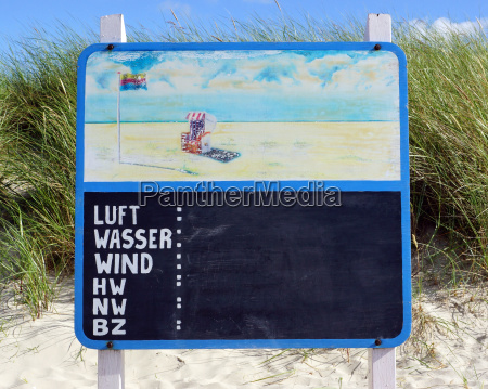 sign on the beach with text