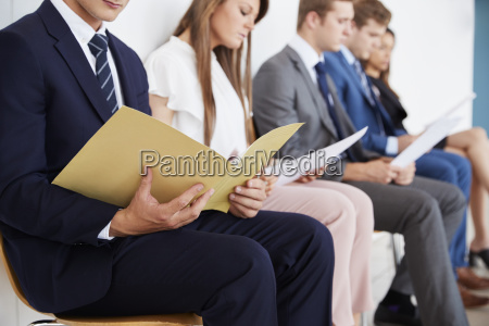 candidates waiting for job interviews mid