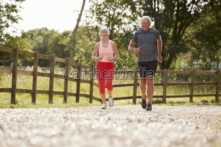 healthy senior couple enjoying run through