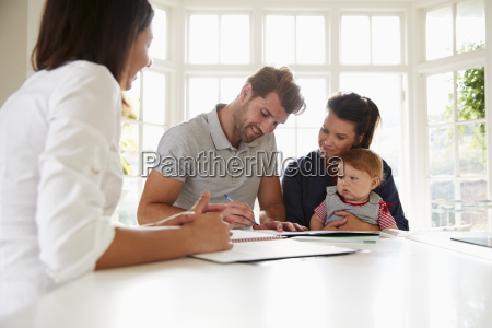 family with baby meeting financial advisor