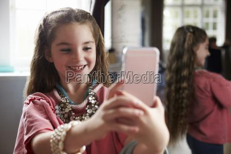 girl playing dressing up game taking