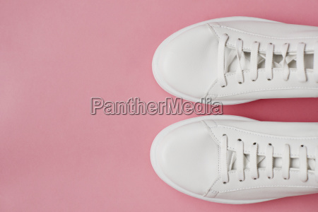 overhead shot of white sneakers on