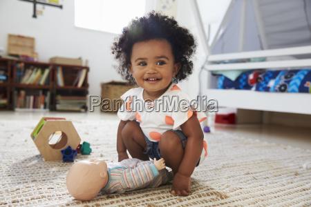 cute baby girl having fun in