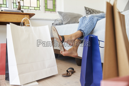 woman back from shopping trip surrounded