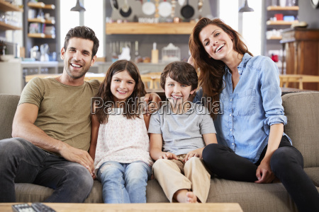 portrait of happy family sitting on