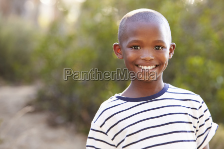 smiling young black boy looking to