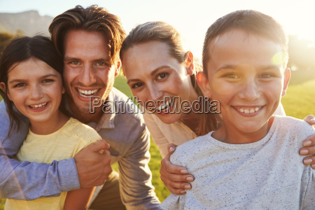 portrait of happy white family embracing