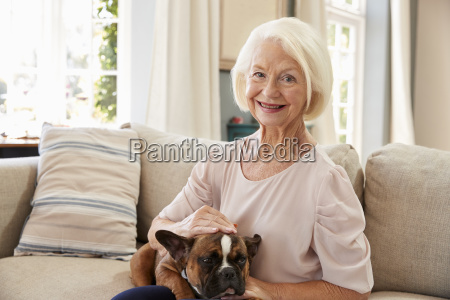 senior woman sitting on sofa at