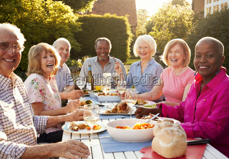 portrait of senior friends enjoying outdoor