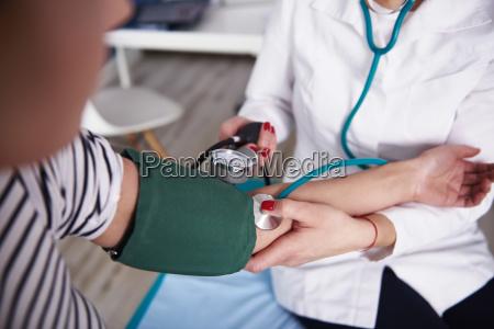 doctor taking blood pressure of