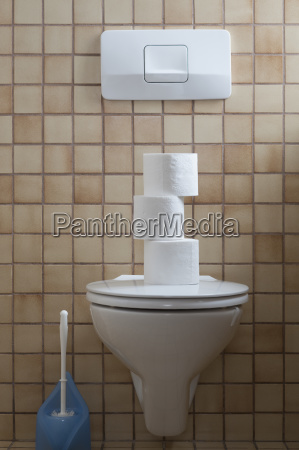 toilet with stack of toilet paper