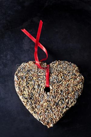 birdseed shaped as a heart