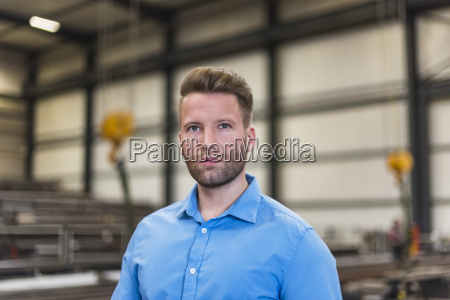 portrait of serious man on factory
