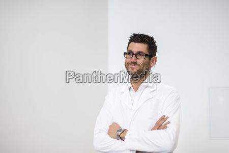 portrait of smiling man wearing work