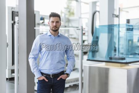 portrait of man in factory