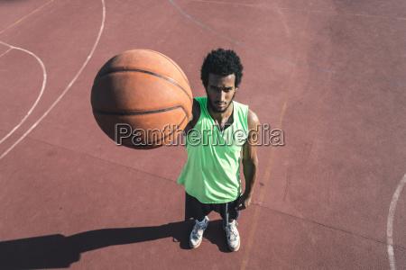 young basketball player holding ball