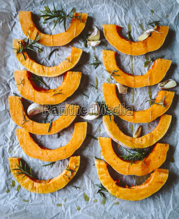 slices of pumpkin garlic rosemary and