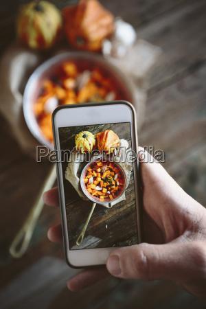 taking photo of casserolle of pumpkin