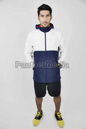 portrait of young man wearing sportswear