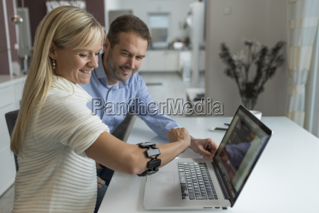 man and smiling woman with wearable