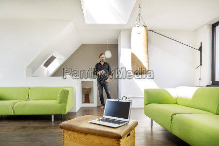 businessman with tablet and laptop at