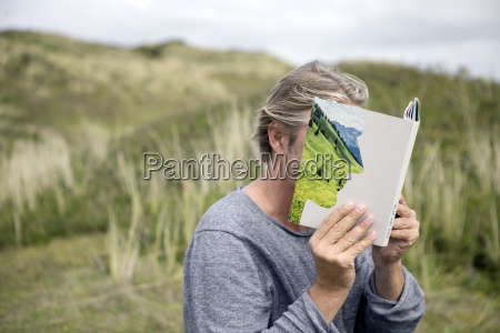 man reading story book in the