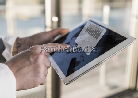 woman using tablet in office with