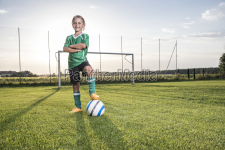 portrait of confident young football player