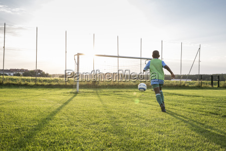 young football player on football ground