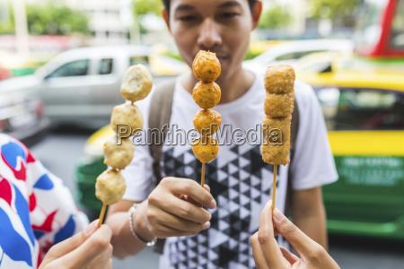 thailand bangkok group of friends eating