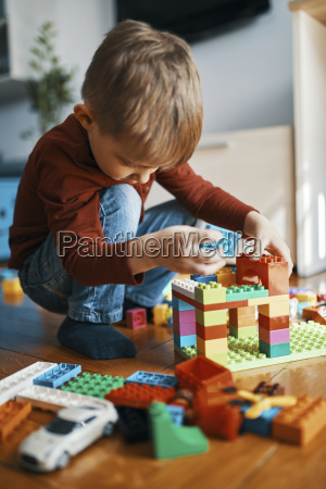 little boy playing with building bricks