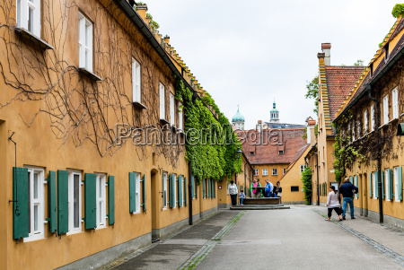 visitors near well in fuggerei housing