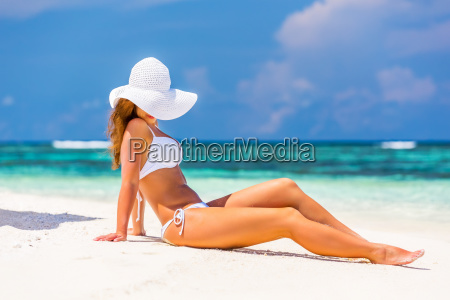 young, woman, on, the, tropical, beach - 25131354