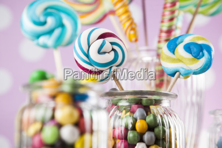 colorful candies in jars on table