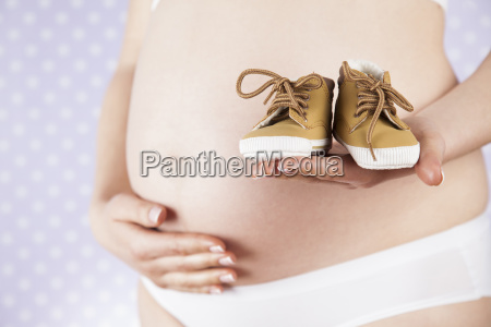 pregnancy, concept, , female, hands, shoes - 25134876