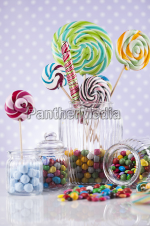 colorful, candies, in, jars, on, table - 25135198