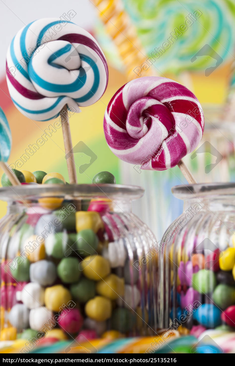 colorful, candies, in, jars, on, table - 25135216