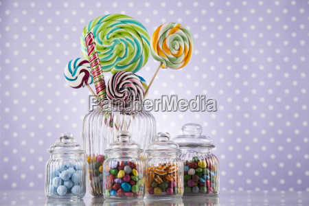 colorful, candies, in, jars, on, table - 25135812