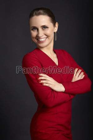 cheerful woman in a red dress