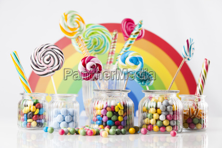 colorful, candies, in, jars, on, table - 25136052