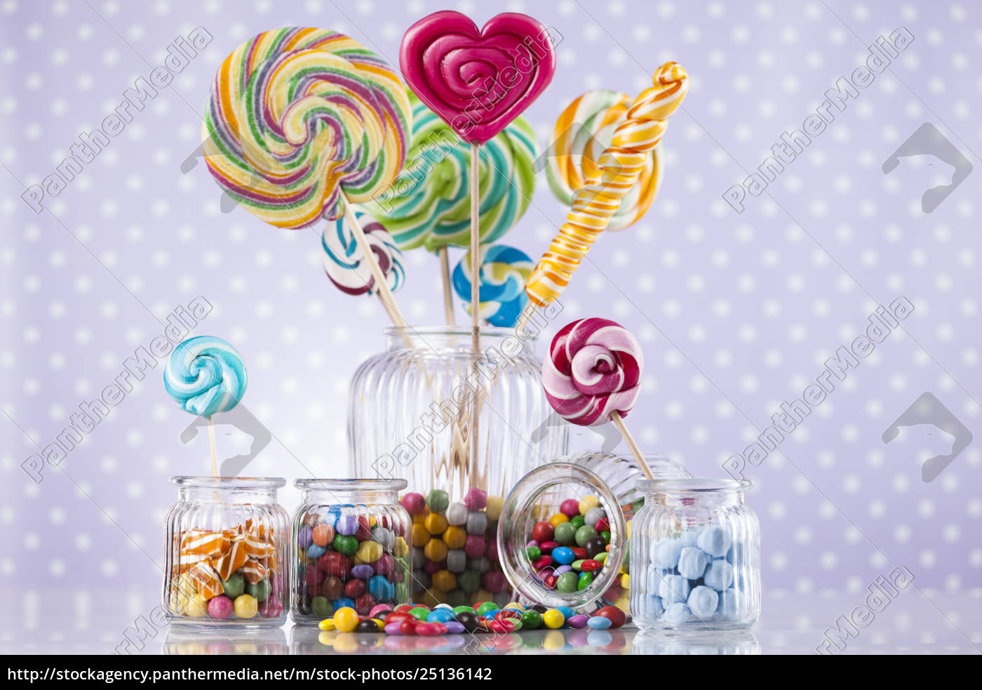 colorful, candies, in, jars, on, table - 25136142