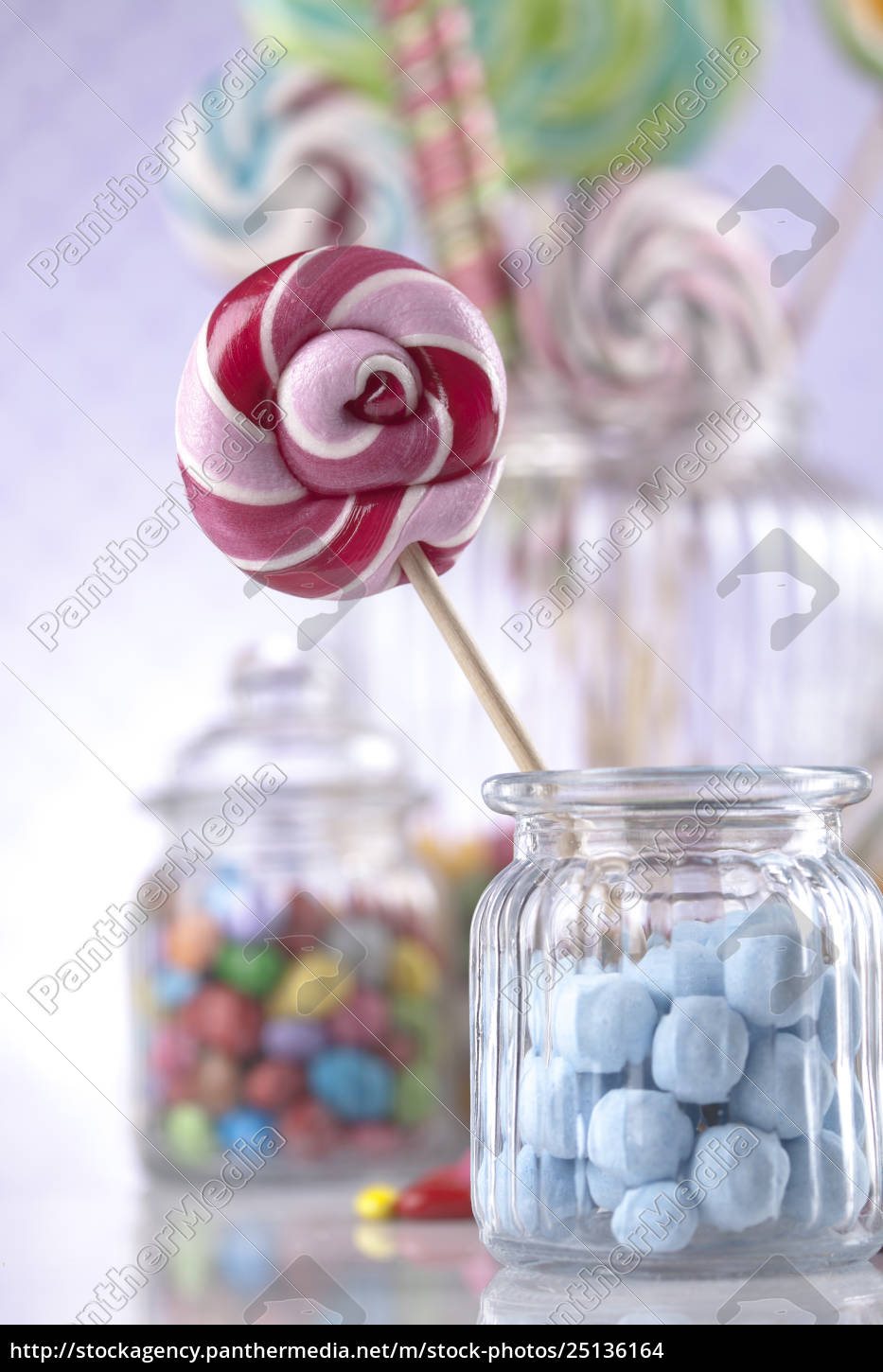 colorful, candies, in, jars, on, table - 25136164