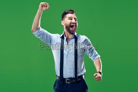 winning success man happy ecstatic celebrating