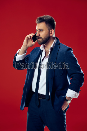 handsome, businessman, with, mobile, phone - 25137542