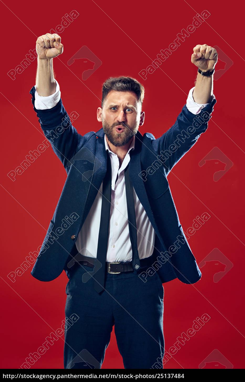 winning, success, man, happy, ecstatic, celebrating - 25137484