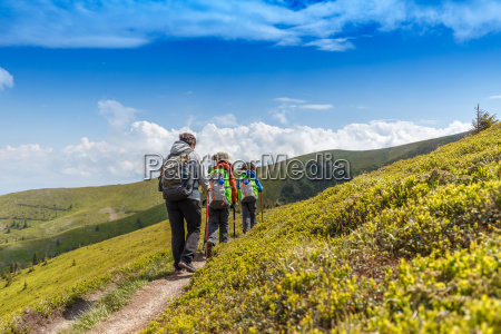hiking woman with her children in