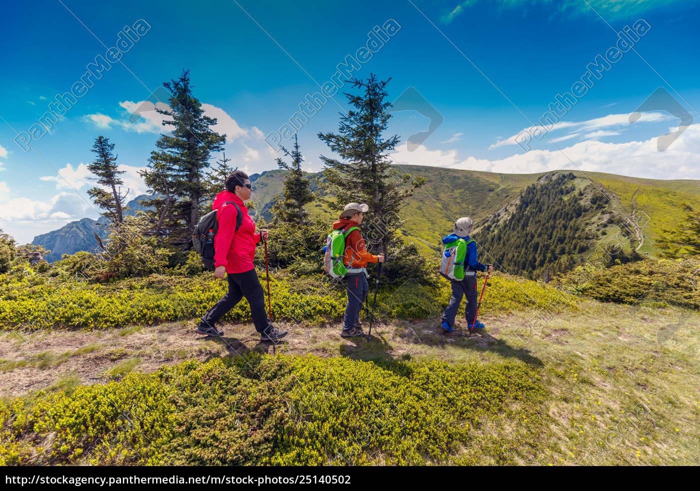 woman, with, her, children, trekiking - 25140502